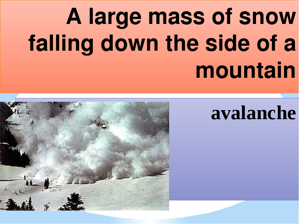 A large mass of snow falling down the side of a mountain avalanche
