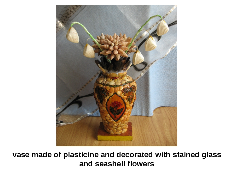 vase made of plasticine and decorated with stained glass and seashell flowers
